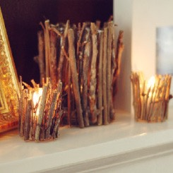1. Forest Vibe: Select several twigs in various shapes and sizes, using a hot glue gun, glue the twigs around a candle for a foresty, mystical vibe.