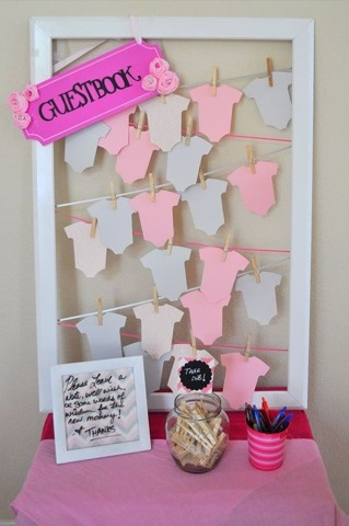 Nice alternative to the regular 'ol guest book. Cut shapes pin to yarn with mini clothes pins.