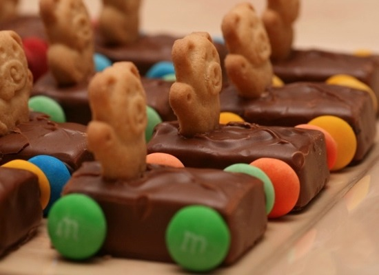 Any chocolate(preferably milky way or musketeers because they are softer) And put little bears and add m 'n' ms