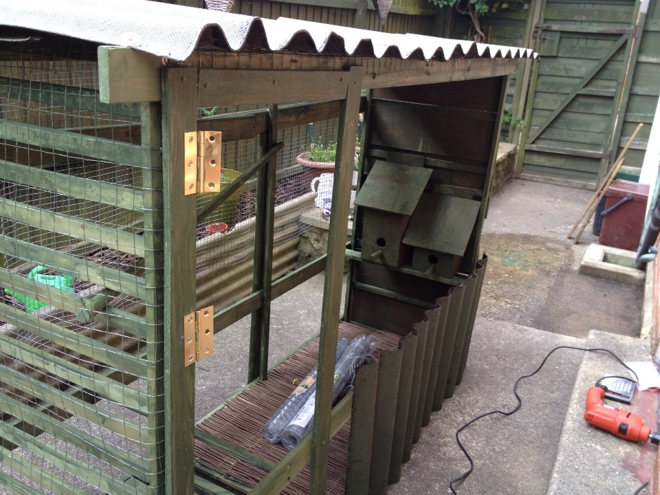 We added wire mesh to the sides and a roof with correlated that was left over from our Wendy house