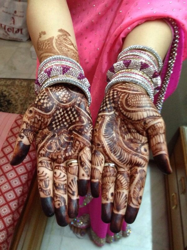 Beautiful mahendi-  Mix Heena overnight with some water, then make a cone of that thick paste and make any design on your hands or legs. Remove it from your skin when it gets dry. It will look like this!