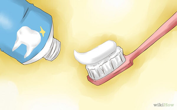 Add toothpaste in a soft toothbrush