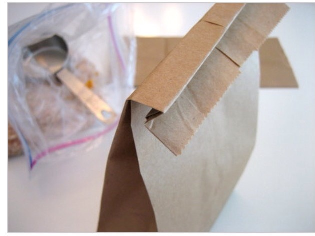 Fold the bag over twice. Don't use staples to secure the bag — this might spark in your microwave.