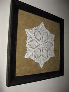 Choose one of your favs (some won't end up laying as flat as you would like find the one that came out looking the nicest) frame the doily and hang in a hallway or empty space that just needs a touch of something!