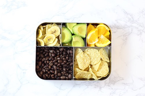 7 | Mexican-Inspired Lunch Combo Ever since my kids were babies they've been polishing off avocados left & right! Whynot throw in some black beans for protein & tortilla chips for dipping action?You can even pack a side of salsa!  1. Black beans 2. Avocado 3. Oranges 4. Tortilla chips 5. Banana