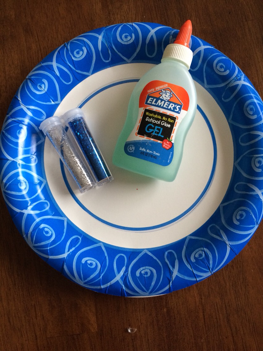 Next get some clear glue and blue glitter. Also grab something to mix it in.