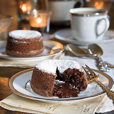 Ingredients: 1 tablespoon butter 1 cup butter 8 ounces bittersweet chocolate morsels 4 egg yolks 4 large eggs 2 cups powdered sugar 3/4 cup all-purpose flour 1 teaspoon instant espresso or instant coffee granules Pinch of salt Garnish: powdered sugar