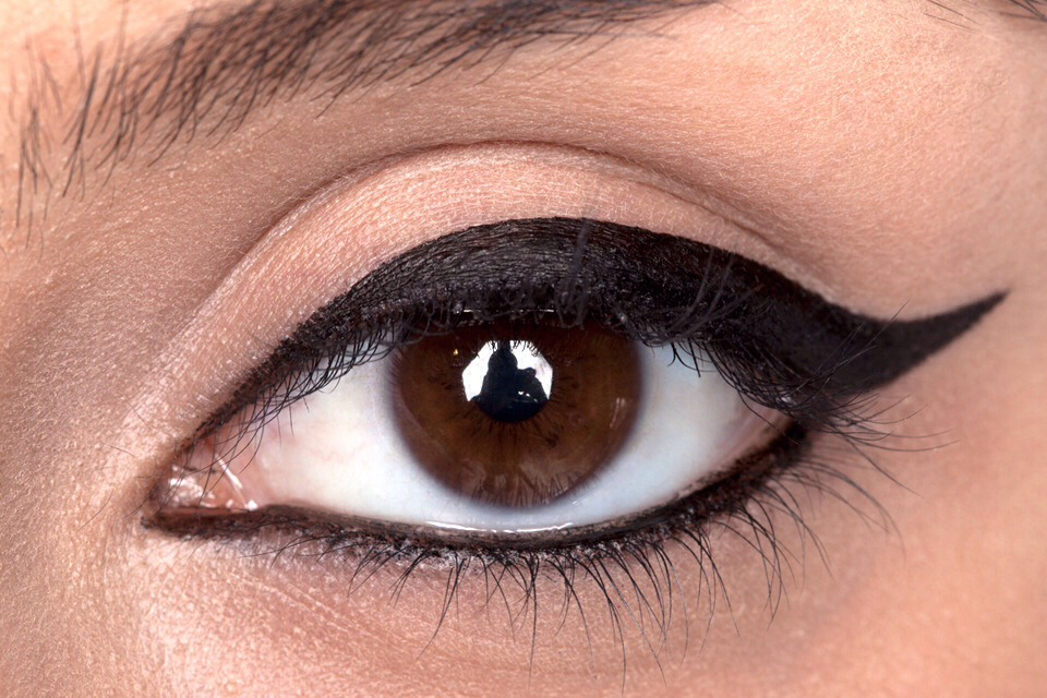 use a cotton bud to dab your waterline. put on your eyeliner as normal.  put eyeshadow over the liner to set it.