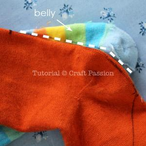 Mark the seam line on the toddler sock as shown in white dash line in the picture. This is the belly of the dragon.