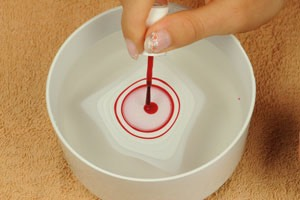 Next you want to take the colors and put a drop of nail polish in the bowl, you want to put the different colors inside the previous circle until it is as big as you want or to fit your finger. Make sure the big drop spread through the whole bowl.