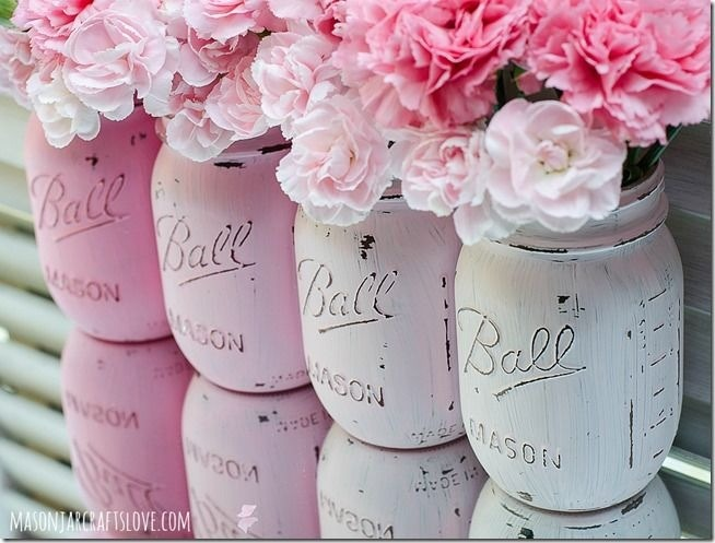 Paint the jar/jars and take sand paper and rough them up. Then put in some cute flowers.