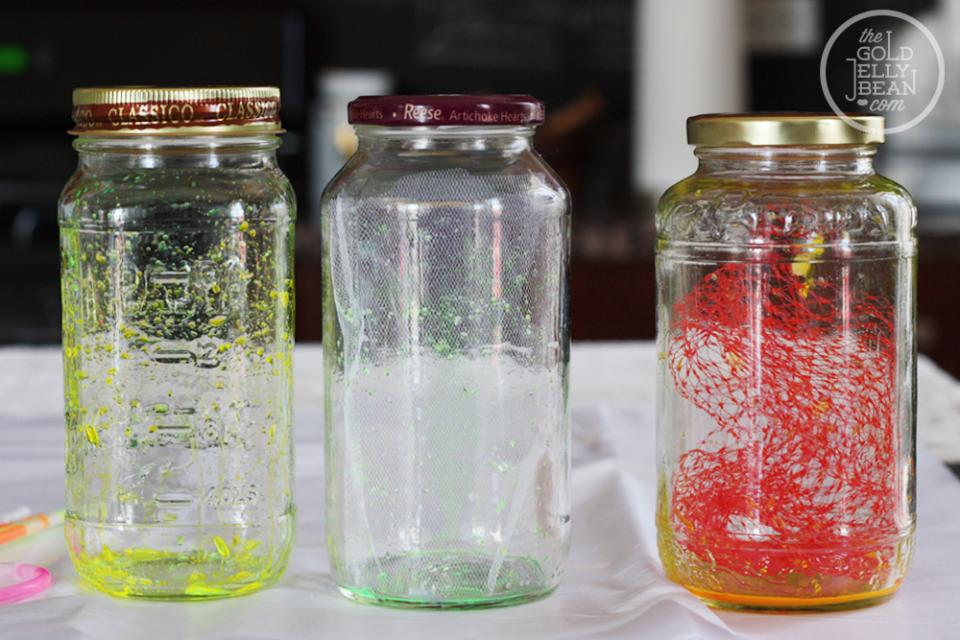 Here are all three jars we made. The first one on the left is just glow stick material by itself. The middle jar uses a piece of white tulle. And the last jar is the one I made for tutorial purposes only.