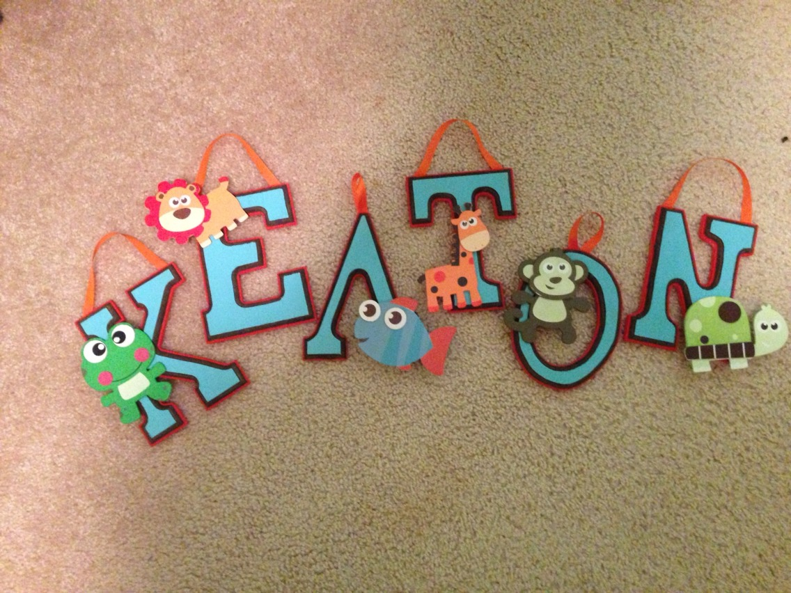 Here's my finished letters all glued together :) they can be used in a nursery, in a kids room, on a door, or really anywhere depending what you spell out :) fun to make and look adorable!