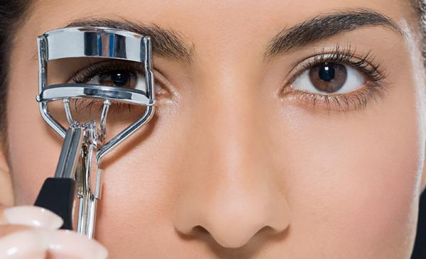 3.	Eyelash Curler & Mascara • Plug heated eyelash curler and let it warm up to appropriate temperature.  • Place your eyelashes inside the curler and instead of curling them pull them infront. Gently perform this so that heat can penetrate into the lashes and straighten it. •After curling, apply