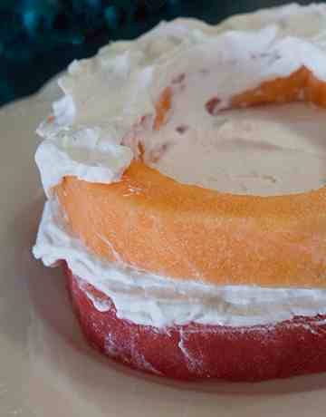 Pat cantaloupe dry and add to cake, add another generous layer of frosting.