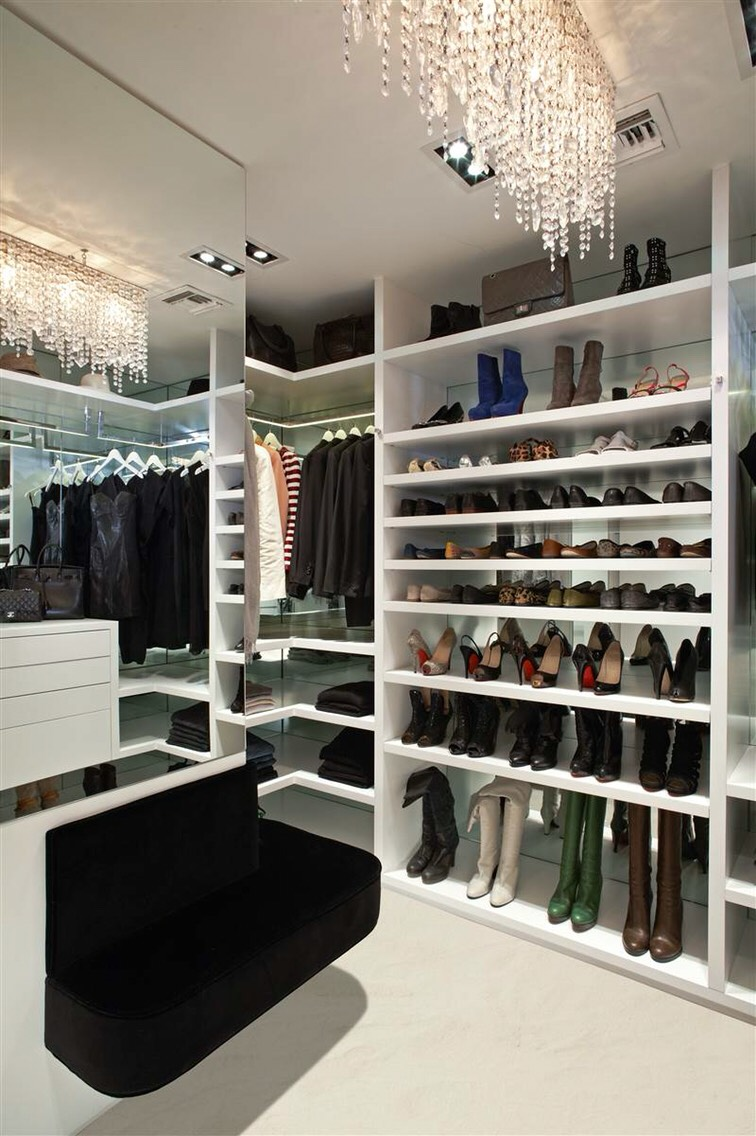 """3. Keep everything within reach. In order to easily access the full vertical height of your closet's storage, keep a stool inside the space, something you can easily push aside when not in use. """"Install a folding step stool in the base toe kick of your closet, so that it's out of sight."""