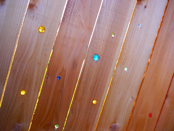 With that electric drill you hustled up you'll want to drill holes in your fence and simply pop the marbles in!