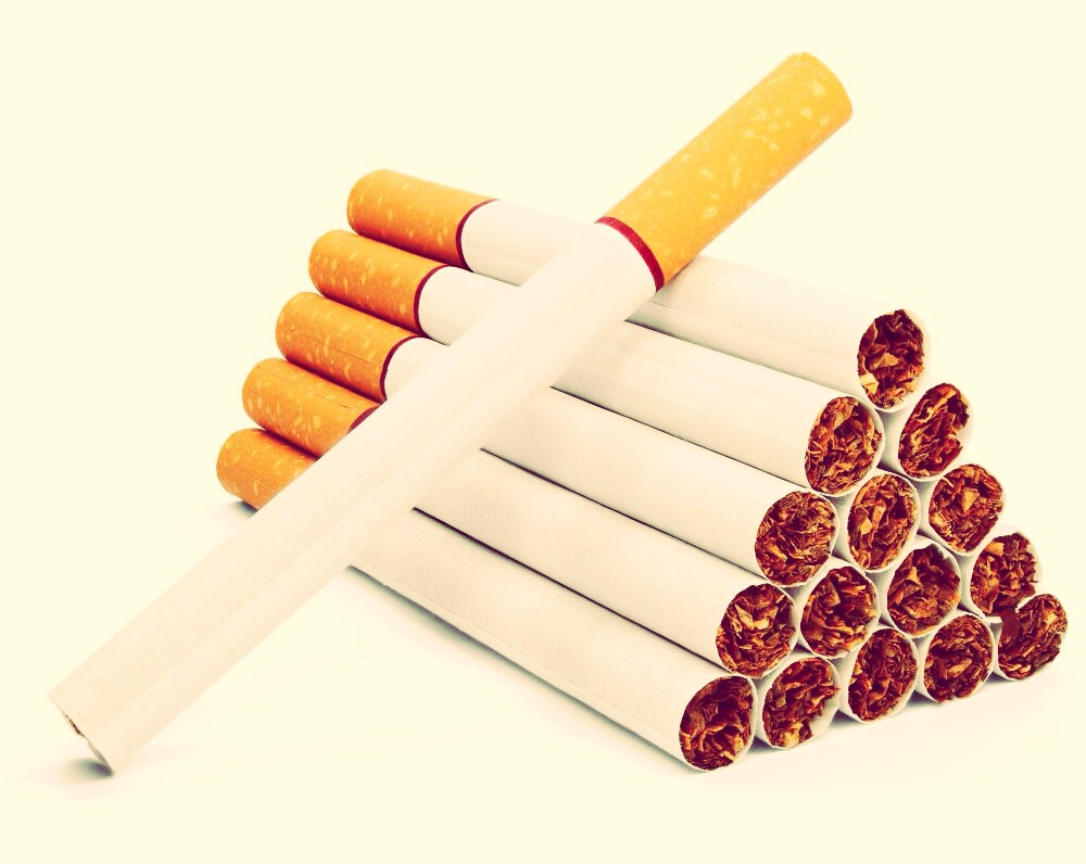 Not only is cigarette smoking bad for you, it is bad for the people and environment around you. Reduce it and ignore the cravings. Try Nicorette or try chewing gum. This can cause cancer because this is terrible for your lungs. Really try to reduce the amount you smoke and hopefully you will quit.