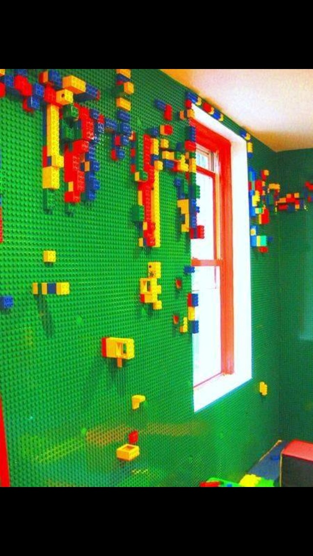 Drill holes into the wall and scew large sheets of Lego to the wall, great for the kids play room!