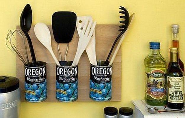 Use tin cans,glue and a spare piece of wood to create utensil holders!:)