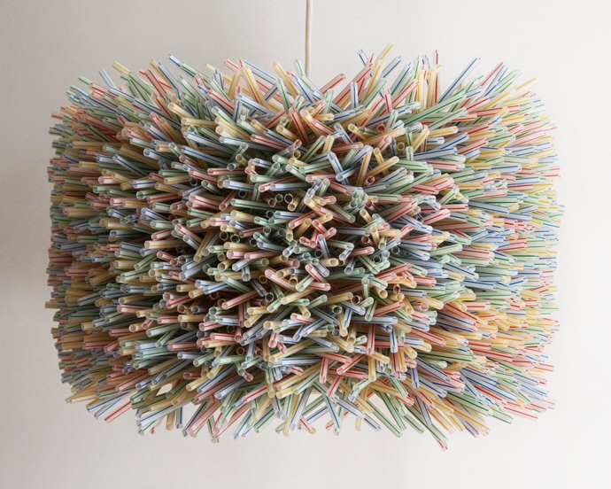 A chandelier made of dozens of plastic straws!