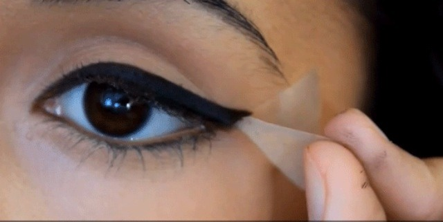 Use tape to get the best eyeliner shape!