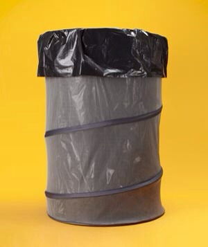 Collapsible Laundry Bins as Garbage Bins During seasonal cleaning binges, soft-sided, handled laundry bins can double as trash cans.