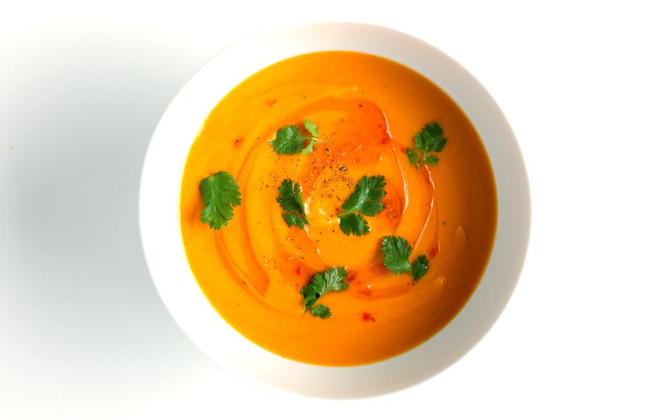 INGREDIENTS ¼ cup (½ stick) unsalted butter     1 pound carrots, peeled, chopped     1 medium onion, chopped     Kosher salt and freshly ground black pepper     2 cups low-sodium chicken broth     13.5-oz. can unsweetened coconut milk     2 tablespoons Thai-style chili sauce plus more for serving