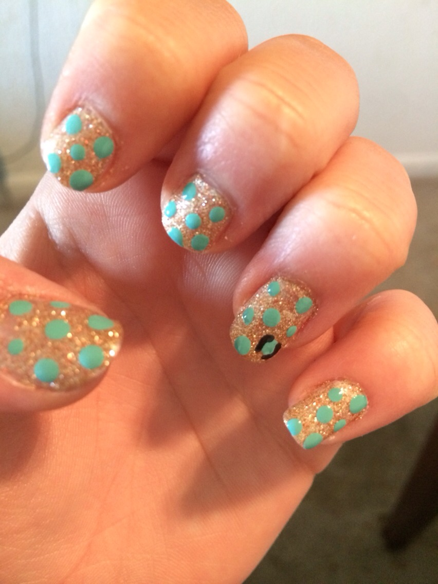 Take the toothpick with the end cut off and put random dots on your nail make sure to leave room around each dot  with the black and the sharp toothpick put brackets and c's around the dots