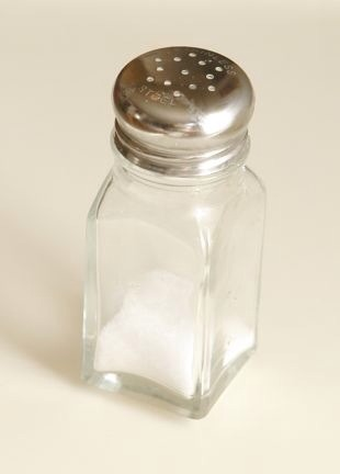 Prevent Your Salt From Clumping  When I worked in restaurants, we were always taught to put a few grains of rice in the salt shakers. It is said that the rice will absorb any excess moisture and keep the salt from clumping.