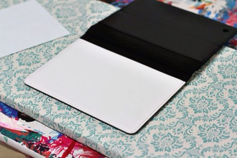 I laid out the blank iPad case onto the ironing board: