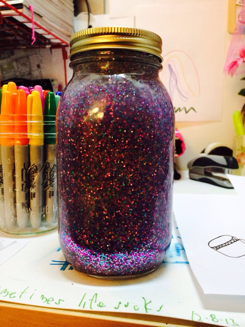 Get a mason jar, or any jar that has a twist able lid! Get tacky glue the more I have the slower it goes down.... Get all the glitter u want any color you want! And water Fill the jar with the water about 90% and then add the glitter and then the glue, then close it and shake until it's all mixed up