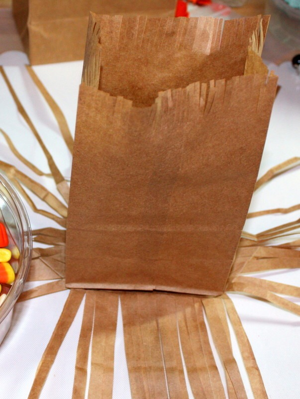 STEPS  STEP 1 You need two lunch-size paper bags for each broomstick. Unfold one bag, and push out its base while folding in the left and right sides. STEP 2 Using scissors, cut the bag into thin strips, stopping short of the base. Cut thin strips into the top inch of the second bag.
