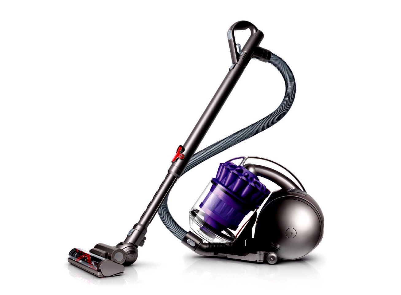 Forget your broom. Most vacuums these days have a bare floor setting. Why would you want to push around the dirt and mess when you could just suck it up in the vacuum.