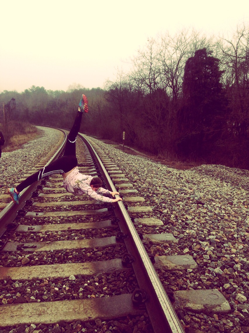 Take pics on a railroad track with your friends