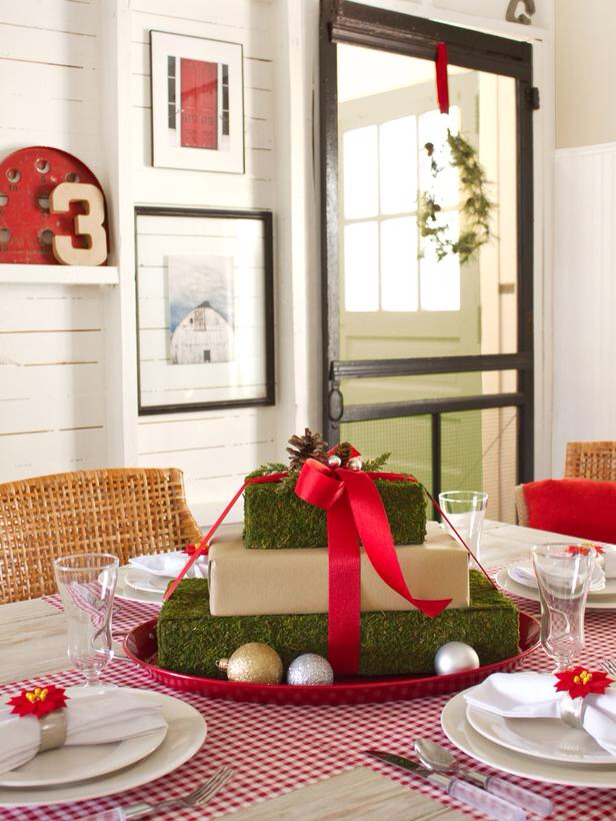 Mossy Gift Box Centerpiece Wow your holiday dinner guests with this eye-catching, nature-inspired gift box centerpiece — here's how to make this moss-covered, ribbon-adorned focal point.