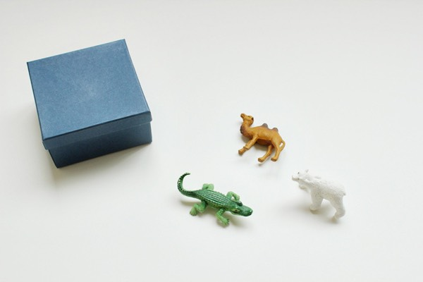 You will need:  blank boxes plastic animals primer craft paint or spray paint paint brush super glue