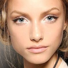 Applying white liner to the lower lash line to make you look more awake and make it look like your eyes are bigger. Also add some to your cupids bow for the illusion of a stronger one