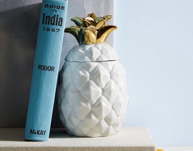 Pineapple Scented Candle This pineapple-shaped ceramic candle is too perfect not too add to your home, no matter what time of year. We think it would look nice as a bookend or placed along a shelf in the living room - so trendy!