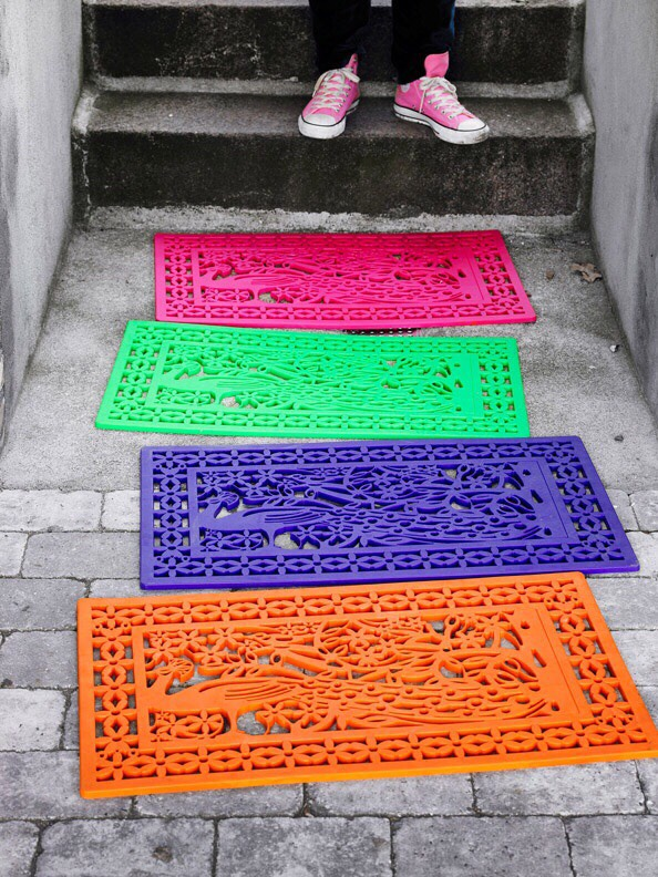 Just spray paint your basic rubber doormat for some fun color
