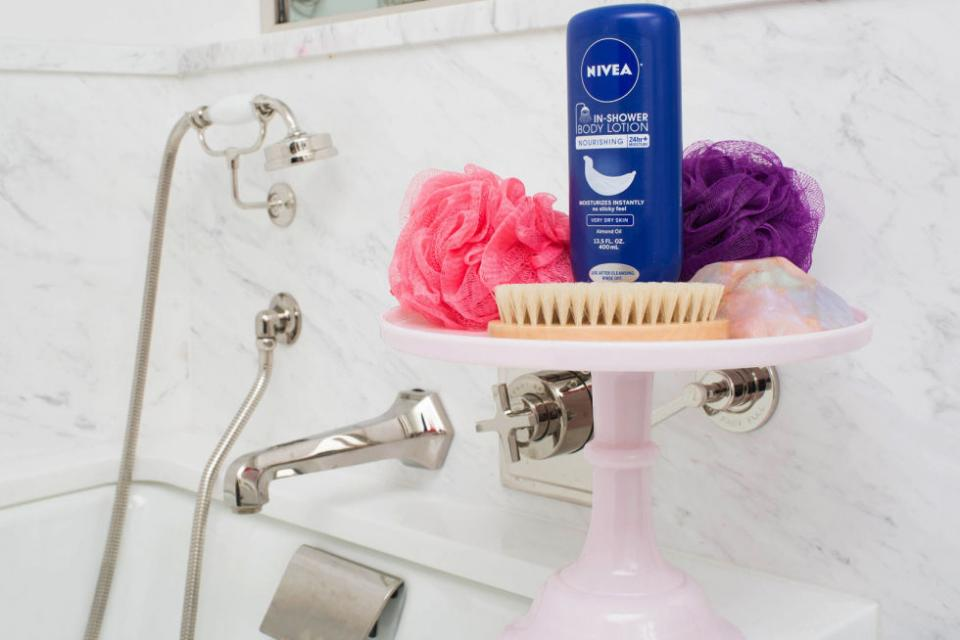 12. Use a cake stand to beautifully store your favorite shower products.