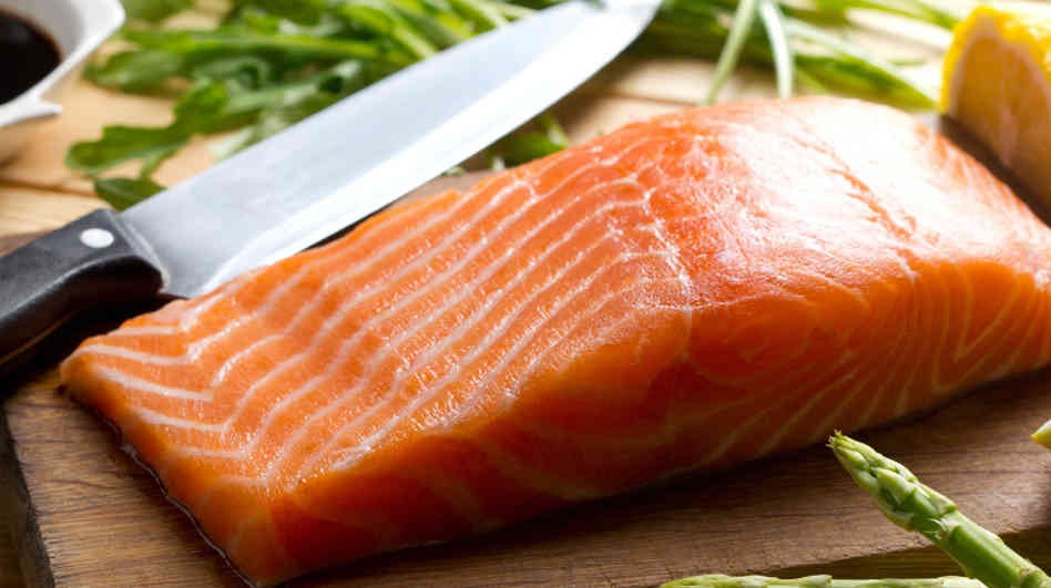 Salmon A plate of salmon is high in Omega-3 and helps fight inflammation.