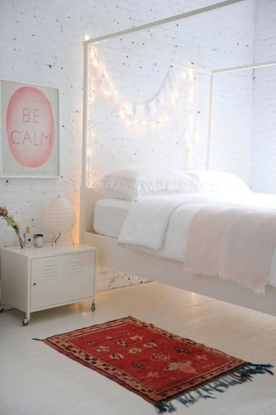 3. You can also toss a strand over the back rungs of your bed frame for easy, instant mood lighting.