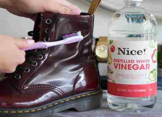 11. Scrub off water stains on leather boots with a soft toothbrush and vinegar.    If your boots are ruined from water, snow, salt, or all of the above, dip a soft-bristled toothbrush in white vinegar and gently rub to remove the stain.