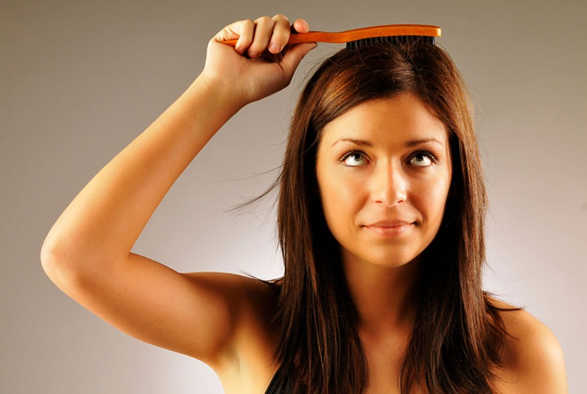 Spritz perfume into hairbrush and comb through hair to make it smell nicer