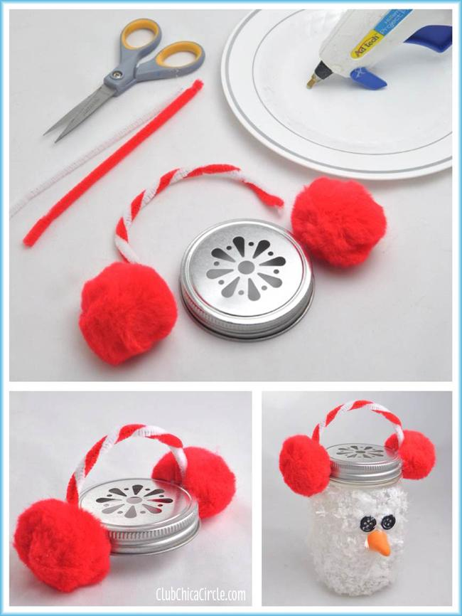 """Cut a red and white pipe cleaner in half and twist them together to make a candy cane pattern. Mold them into a """"U"""" shape that fits the width of the lid.  Using your glue gun, apply each end of the twisted pipe cleaner and the two large red pom poms on the outer edge of a mason jar lid."""