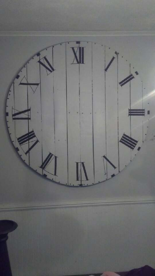 DIY oversize wall clock Line pallet boards together. Secure with a board going across the top and bottom with screws.  Cut to circle shape. Paint, stain clock then add numbers.
