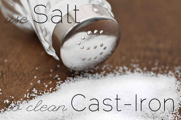 Clean greasy cast-iron with a sprinkle of salt, a little bit of water, and paper towels to scrub