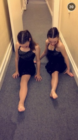 Here's me and my friend doing the forward splits😊