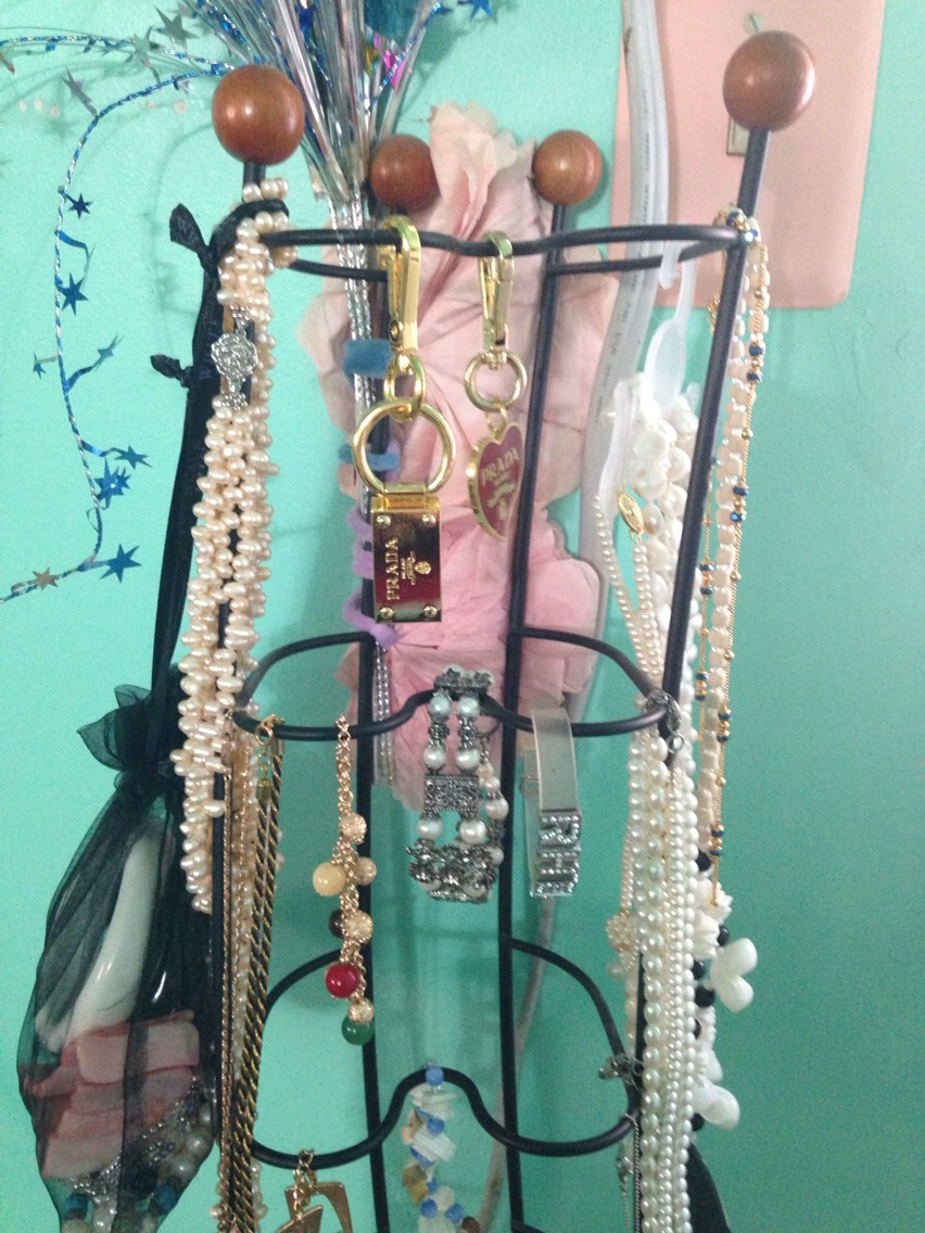 Display for jewelry with unused CD tower.